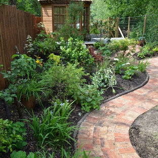 This is an example of a small traditional back fully shaded garden for summer in Surrey.
