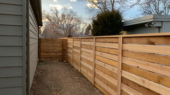 Semi Private Horizontal Fence w/ 1/2 picket spacing, post covers and top cap.