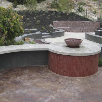 Design ideas for a contemporary retaining wall landscape in San Luis Obispo.