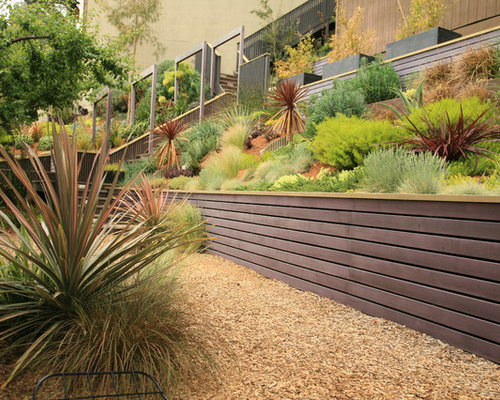 Attrayant Inspiration For A Large Modern Drought Tolerant And Partial Sun Backyard  Concrete Paver Retaining Wall