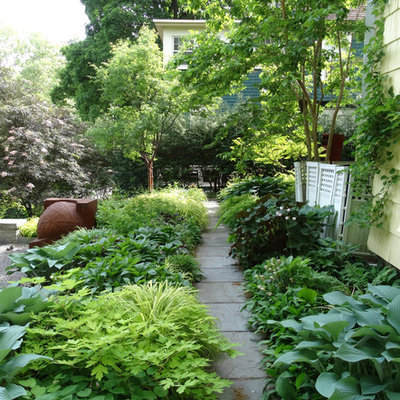 Photo of a large traditional partial sun side yard gravel landscaping in New York for summer.