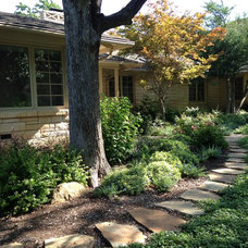 Rustic Landscape by Roundtree Landscaping, Inc