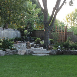Design ideas for a large traditional shade backyard stone garden path in Toronto.