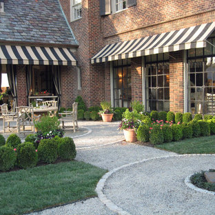 This is an example of a small traditional partial sun courtyard gravel landscaping in New York.