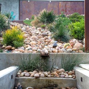 Design ideas for an asian full sun water fountain landscape in San Diego.