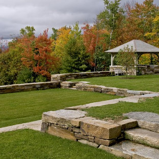 Photo of a large victorian backyard landscaping in Burlington.