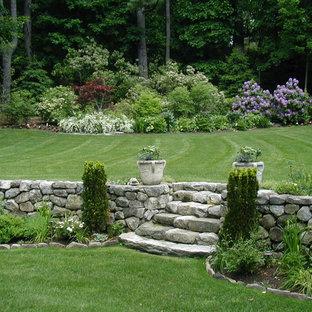 Design ideas for a huge victorian backyard lawn edging in Boston.