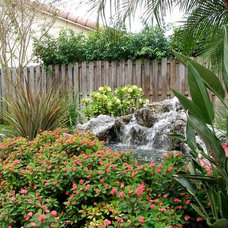 Traditional Landscape by Showcase Gardens
