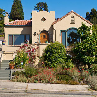 Example of a southwest beige one-story exterior home design in San Francisco