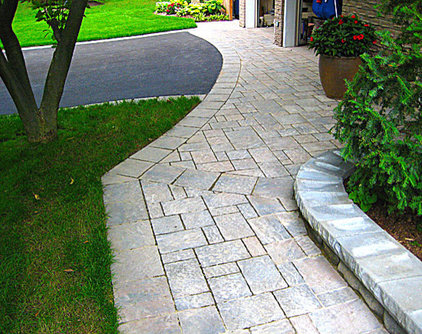 Traditional Landscape by Simple Solutions Landscaping