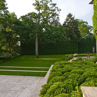 Photo of a large modern full sun backyard concrete paver landscaping in Chicago.