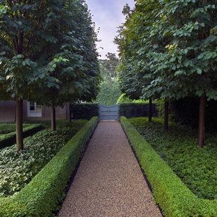 This is an example of a large modern partial sun backyard gravel landscaping in Chicago.