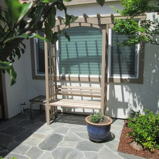 Photo of a small asian partial sun front yard stone landscaping in San Francisco for fall.