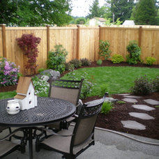 Traditional Landscape by Puget Sound Landscaping, Inc.