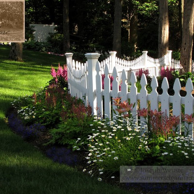 Design ideas for a mid-sized traditional partial sun backyard landscaping in Newark for spring.