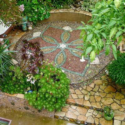 Photo of an eclectic backyard stone landscaping in San Francisco.