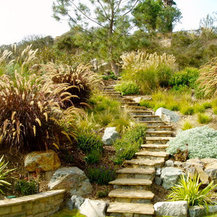 Inspiration for a craftsman retaining wall landscape in San Diego.