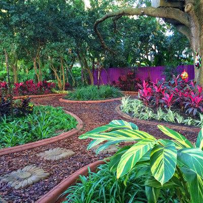 Inspiration for a mediterranean shade mulch garden path in Tampa.