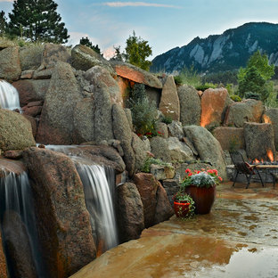 Photo of a large eclectic backyard waterfall in Denver.