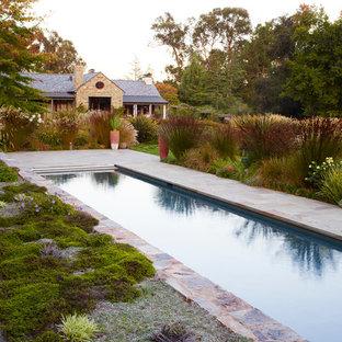 Inspiration for a huge mediterranean backyard stone water fountain landscape in San Francisco.