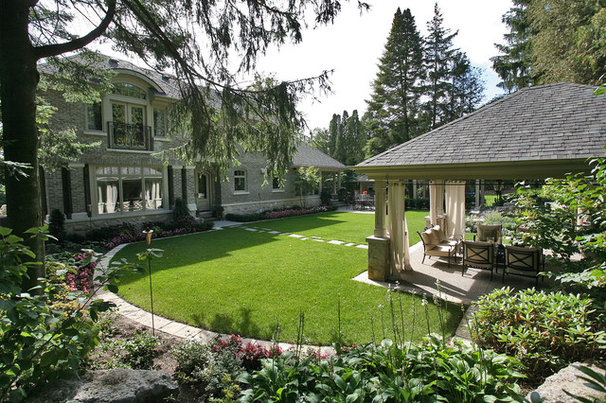 Traditional Landscape by Foremost Construction Inc