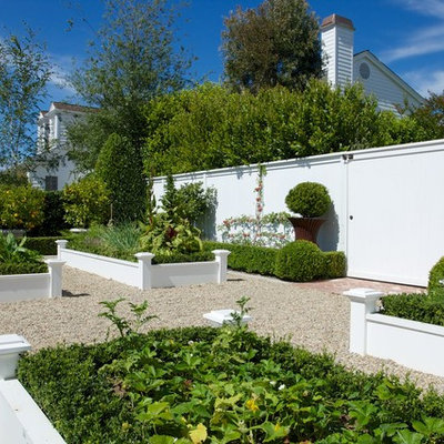 This is an example of a traditional full sun backyard gravel raised garden bed in Los Angeles.