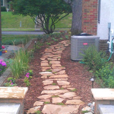 Traditional Landscape by Drawn by Nature Landscaping