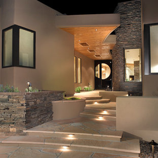 Photo of a front yard partial sun formal garden in Phoenix with natural stone pavers.