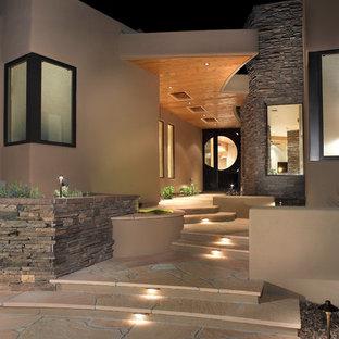 Esempio di un giardino formale stile americano esposto a mezz'ombra davanti casa con pavimentazioni in pietra naturale
