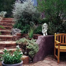 Eclectic Landscape by JSL Exteriors Landscape Design/Build