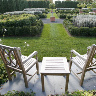 Photo of a large traditional backyard formal garden in New York.