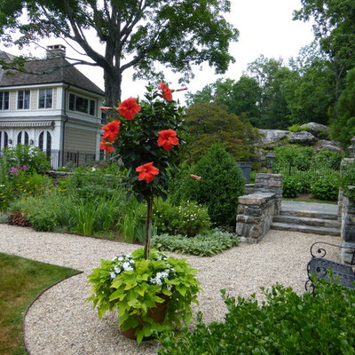 Photo of a large traditional full sun backyard formal garden in New York for summer.