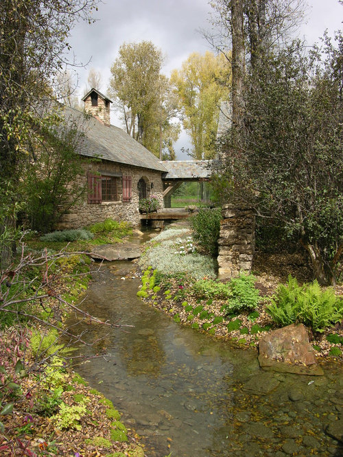 Stone cottage houzz for Traditional landscape