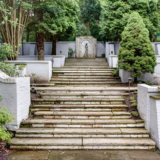Photo of a victorian shade backyard stone formal garden in Other.