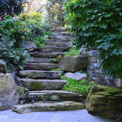 Photo of a large traditional partial sun backyard stone garden path in DC Metro.