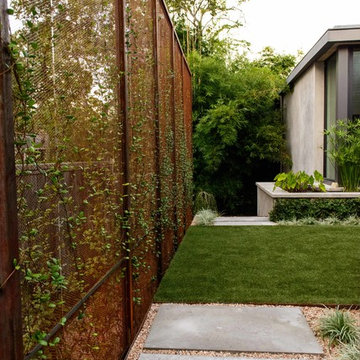 Steel Privacy Walls Create Outdoor Room