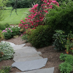 This is an example of a small traditional hillside stone landscaping in DC Metro.