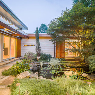 This is an example of a mid-sized asian courtyard concrete paver landscaping in Raleigh.