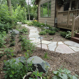 This is an example of a mid-sized traditional backyard stone garden path in Minneapolis.