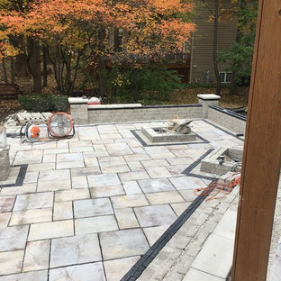 Inspiration for a large modern backyard brick landscaping in Chicago.