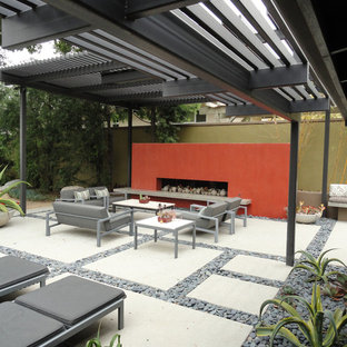 Inspiration for a mid-sized modern shade backyard concrete paver landscaping in Los Angeles with a fire pit.