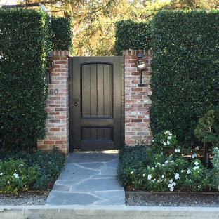 Photo of a medium sized traditional front fully shaded garden in Los Angeles with natural stone paving.