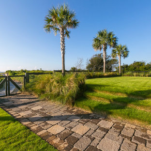 Design ideas for a coastal full sun backyard concrete paver garden path in Charleston.