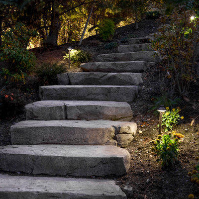 Design ideas for a mid-sized traditional shade hillside stone landscaping in Seattle.