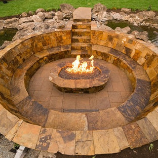 Inspiration for a large arts and crafts backyard full sun garden in Other with a fire feature and natural stone pavers.