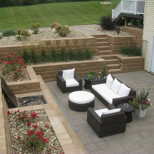 Inspiration for a large traditional side yard concrete paver retaining wall landscape in Minneapolis.