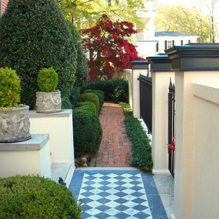 Inspiration for a traditional front yard brick landscaping in Atlanta.