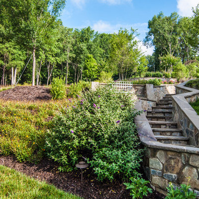 Inspiration for a huge traditional full sun backyard stone landscaping in Charlotte for spring.