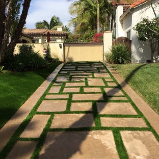 Design ideas for a contemporary front yard concrete paver driveway in Los Angeles.