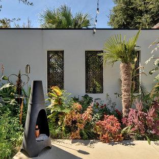 Eklektischer Garten mit Kamin in Austin
